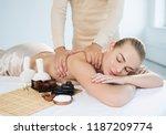 masseur doing massage on woman... | Shutterstock . vector #1187209774