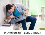young man husband repairing tv... | Shutterstock . vector #1187248024