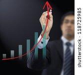 businessman drawing graph | Shutterstock . vector #118725985