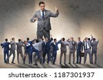 boss employee manipulating his... | Shutterstock . vector #1187301937