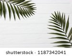 palm leaves on a wooden... | Shutterstock . vector #1187342041