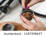 filling a hookah bowl with... | Shutterstock . vector #1187398657