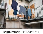 colored clothes are dried lace... | Shutterstock . vector #1187398711