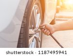 man checking air pressure and... | Shutterstock . vector #1187495941
