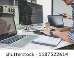 programmers cooperating at... | Shutterstock . vector #1187522614