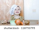beautiful cute little cook with ...