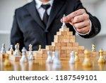 wooden game of strategy  hands... | Shutterstock . vector #1187549101
