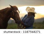 woman with her horse in evening ... | Shutterstock . vector #1187568271