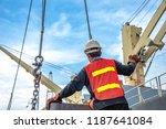gang of stevedore labor working ... | Shutterstock . vector #1187641084