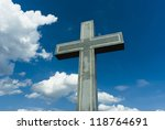 marble cross on the hill, blue sky with clouds - stock photo