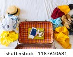 suitcase with winter and summer ... | Shutterstock . vector #1187650681