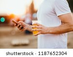 close up of a man using mobile... | Shutterstock . vector #1187652304