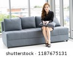 businesswoman sat at the sofa ... | Shutterstock . vector #1187675131