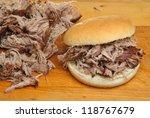 Hog roast or pulled pork roll. - stock photo