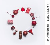 Small photo of Christmas round circle frame composition on white background, top view. Red Christmas decoration and gift wrapping and package objects flat lay. Copy space for your design