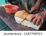 closeup of long loafs cutting...   Shutterstock . vector #1187740921