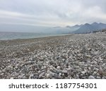 stony mediterranean beach in... | Shutterstock . vector #1187754301