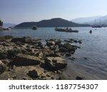 stony mediterranean beach in... | Shutterstock . vector #1187754307