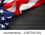 American Flag On Dark Wooden...