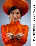 Young vietnamese woman. Focus on hands. - stock photo