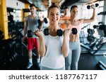 young woman doing exercise with ... | Shutterstock . vector #1187767117
