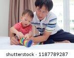 asian father teaching cute... | Shutterstock . vector #1187789287