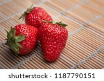 three red strawberries | Shutterstock . vector #1187790151
