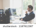 young businessman holding a... | Shutterstock . vector #1187812387