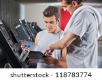 instructor guiding man to fill... | Shutterstock . vector #118783774