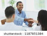 closeup.handshake manager and... | Shutterstock . vector #1187851384