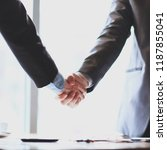 close up.confident handshake of ...   Shutterstock . vector #1187855041