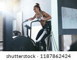 workout at gym. woman training... | Shutterstock . vector #1187862424