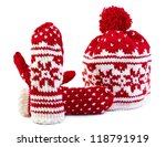 winter cap and mittens hand knitted with jacquard motifs, isolated - stock photo