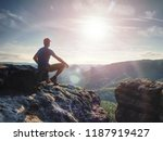 hiker watching to sun at... | Shutterstock . vector #1187919427