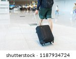 young man wearing shorts and... | Shutterstock . vector #1187934724