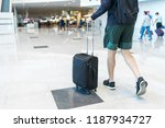 young man wearing shorts and... | Shutterstock . vector #1187934727