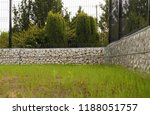the fence is made of gabions... | Shutterstock . vector #1188051757