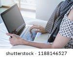 asian woman using computer... | Shutterstock . vector #1188146527
