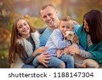 autumn portrait of happy family ...   Shutterstock . vector #1188147304