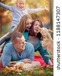 autumn portrait of happy family ... | Shutterstock . vector #1188147307