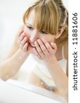 Young Woman Washing Her Face I...