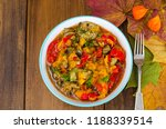 bowl with vegetable stew.... | Shutterstock . vector #1188339514