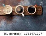 coffee cups on wooden board.... | Shutterstock . vector #1188471127