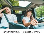 woman driver  man next to her.... | Shutterstock . vector #1188504997