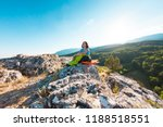 a woman is sitting in a... | Shutterstock . vector #1188518551