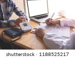 the doctor is discussing with...   Shutterstock . vector #1188525217