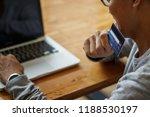 asian man holding credit card...   Shutterstock . vector #1188530197