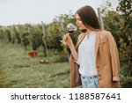 vintner woman tasting red wine... | Shutterstock . vector #1188587641