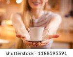 happy woman standing in kitchen ... | Shutterstock . vector #1188595591