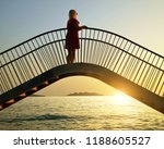 woman standing on a bridge and... | Shutterstock . vector #1188605527